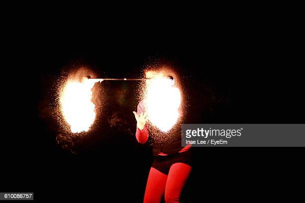 Fire Dancer Woman Performing At Night