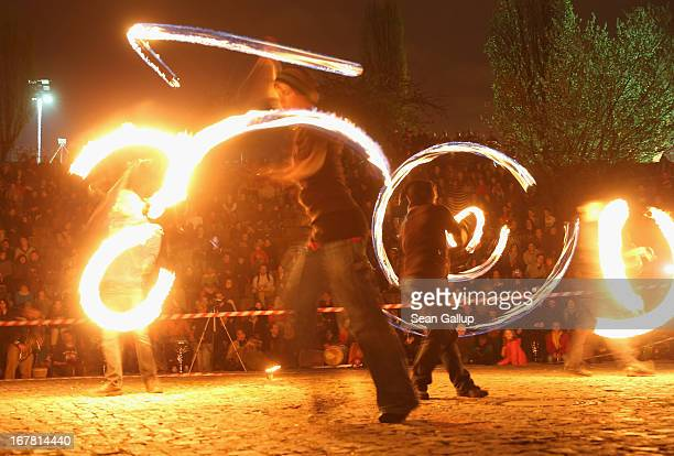 Fire dancers perform in Mauerpark park on Walpurgis night on April 30 2013 in Berlin Germany Walpurgis night is celebrated in many parts of central...