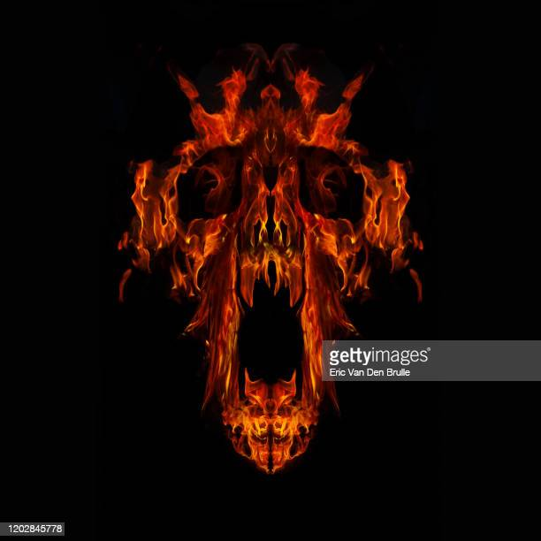 fire demon face against black - eric van den brulle fotografías e imágenes de stock