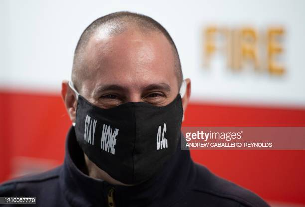 A fire department employee looks on as he wears a mask at the Washington DC Fire and Emergency Medical Services Department's decontamination facility...
