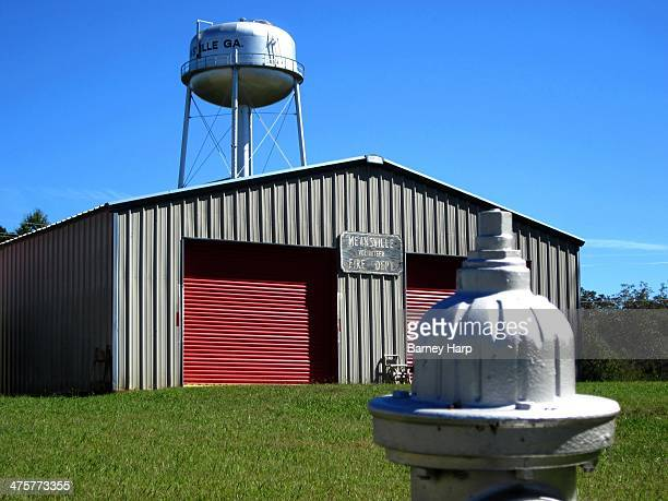 CONTENT] Fire Department in Meansville with water tower and hydrant