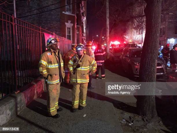 Fire Department of New York City members operate on scene of a blaze at an apartment building in Bronx borough of New York City USA on December 28...