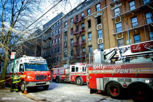 A fire Department of New York personnel works on the scene of an apartment fire is in the Bronx borough of New York City is seen on December 29 2017...