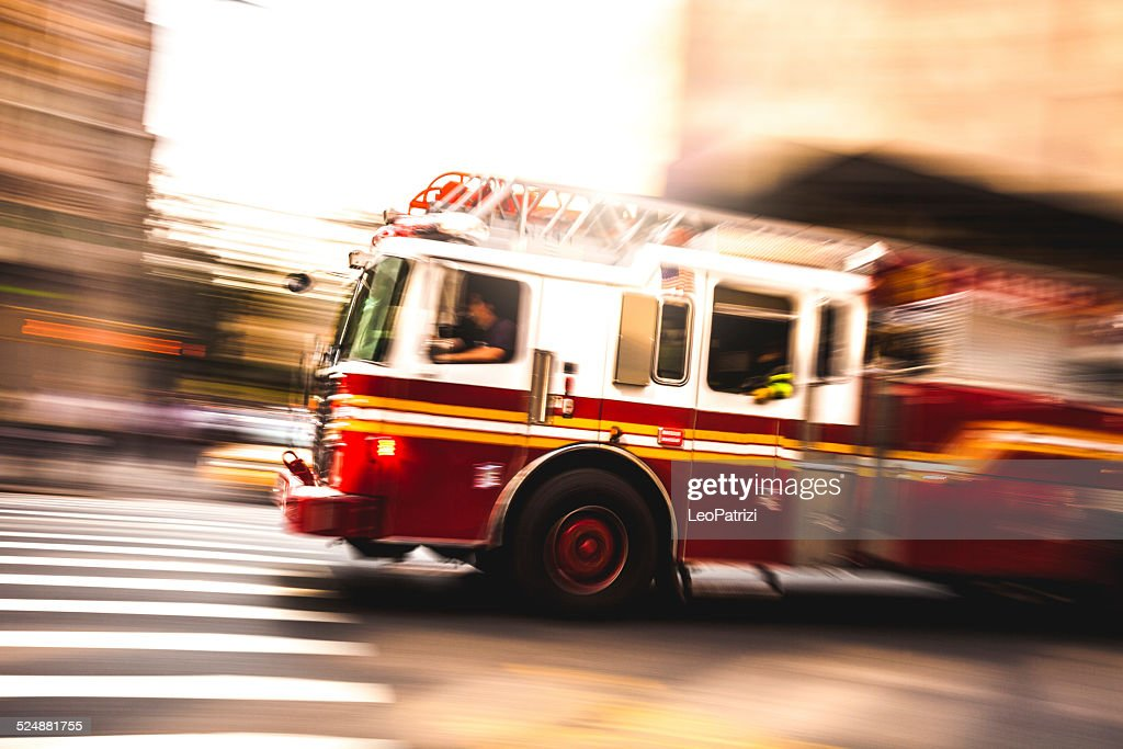 Fire department truck in emergency : Stock Photo