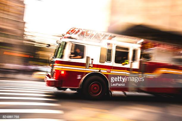 fire department truck in emergency - firefighter stock pictures, royalty-free photos & images