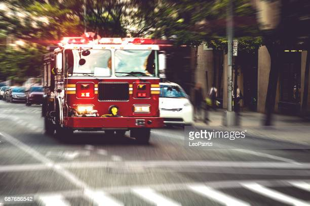 fire department truck in emergency - firetruck stock photos and pictures