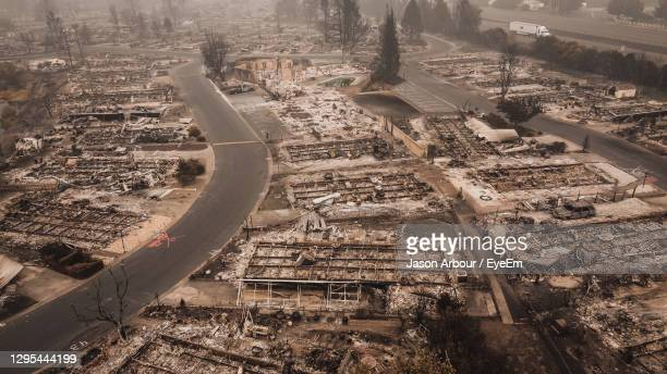 fire destroys many people's homes and ruins their life after fire had blown through town. - destruction stock pictures, royalty-free photos & images