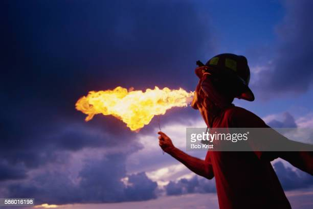 Fire Eater Breathing Fire at the Sunset Celebration