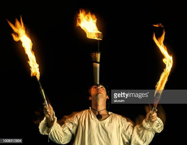 fire eater doing fire performance - juggling stock pictures, royalty-free photos & images
