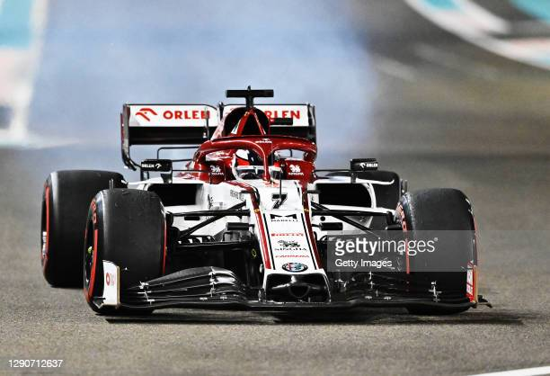 Fire emerges from the car of Kimi Raikkonen of Finland driving the Alfa Romeo Racing C39 Ferrari during practice ahead of the F1 Grand Prix of Abu...