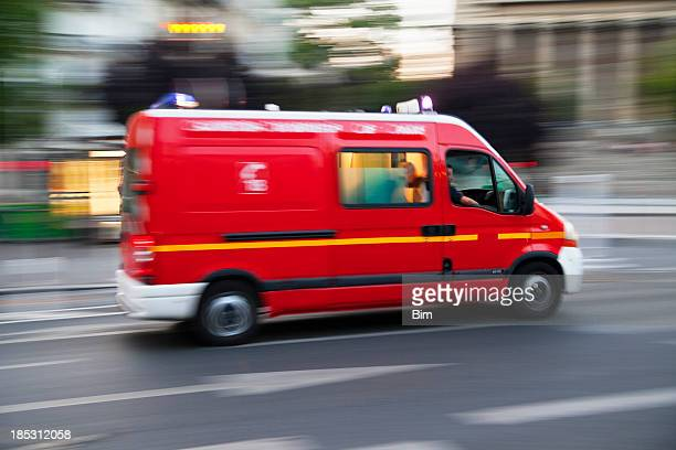 fire engine ambulance speeding, blurred motion, paris - france stock pictures, royalty-free photos & images