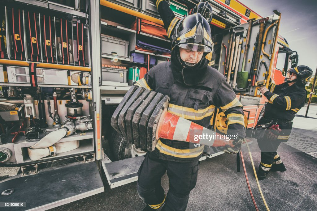 Fire engine and firefighters : Stock Photo