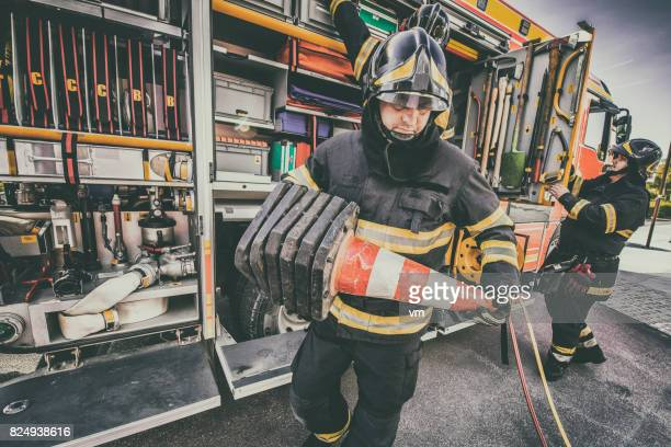 fire engine and firefighters - rescue worker stock pictures, royalty-free photos & images