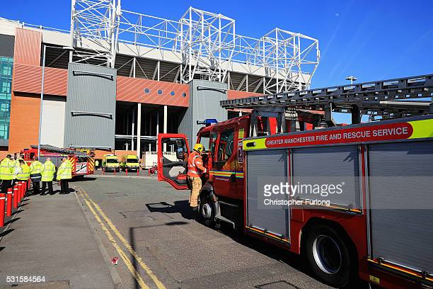 A fire engine arrives at the ground following a security alert and the subsequent abandonment of the Barclays Premier League match between Manchester...