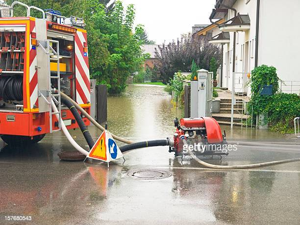 fire engine at work pumping water - water pump stock pictures, royalty-free photos & images