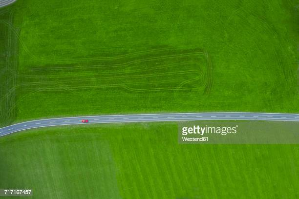 Fire engine driving on country road, aerial view
