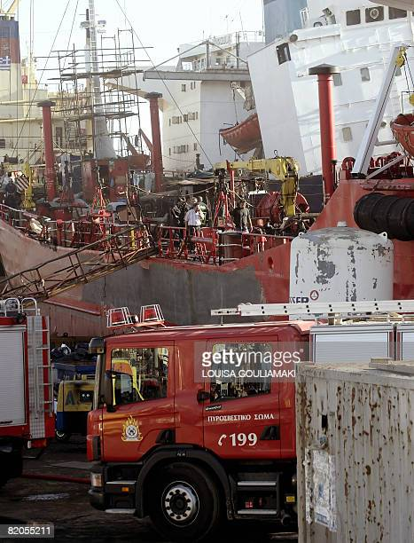 A fire engine is parked beside the listing repair moored Panamaflagged tanker 'Friendshipgas' in the port of Perama near Athens on July 24 2008 Four...