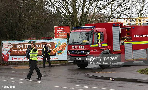 A fire engine leaves Chessington World of Adventures theme park on December 21 2013 in Chessington England A small fire has been reported in a cafe...
