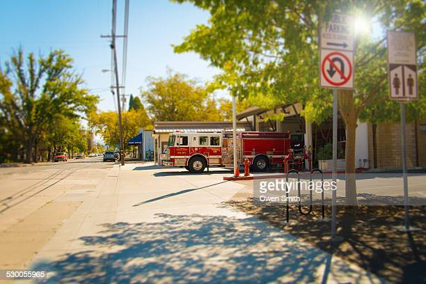 fire engine leaving fire station, calistoga, california, usa - fire station stock photos and pictures