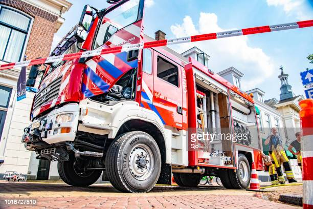Fire engine of the Dutch fire department in the old town of Kampen