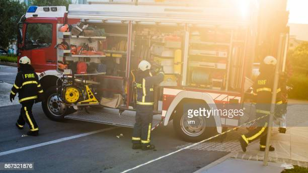fire engine - firefighter stock pictures, royalty-free photos & images