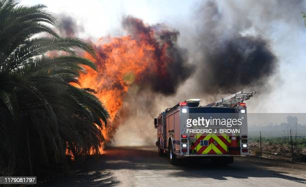 A fire engine reverses as fire erupts close to one of many ranches near the Ronald Reagan Presidential Library in Simi Valley California during the...