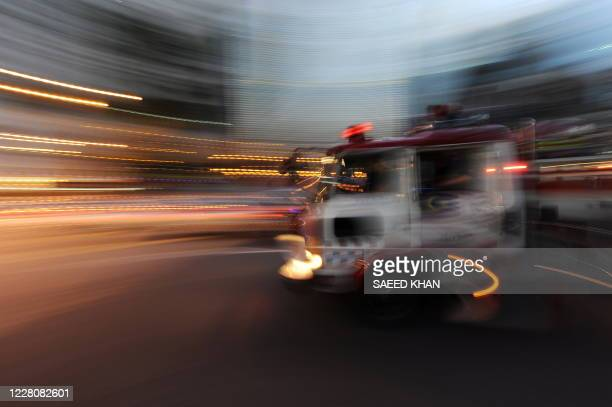 Fire engine rushes to monitor the situation in down town Kuala Lumpur on September 30 due to tremors caused by a powerful earthquake in neighbouring...