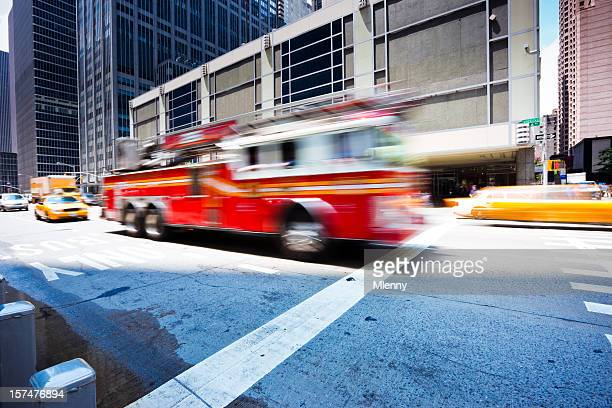Fire Engine rushing through sixth avenue New York City