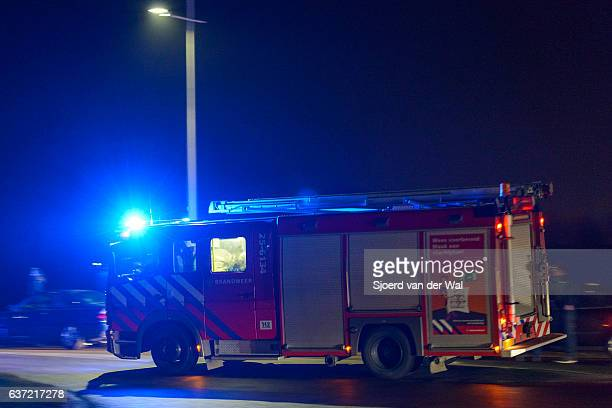 Fire engine rushing towards a fire at night