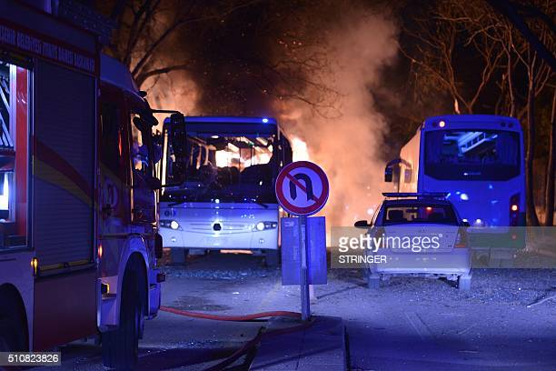 A fire engine stands at the site of an explosion after an attack targeted a convoy of military service vehicles in Ankara on February 17 2016 At...
