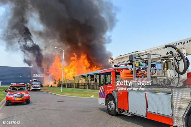 """fire engines at a fire in an industrial area - """"sjoerd van der wal"""" stock pictures, royalty-free photos & images"""