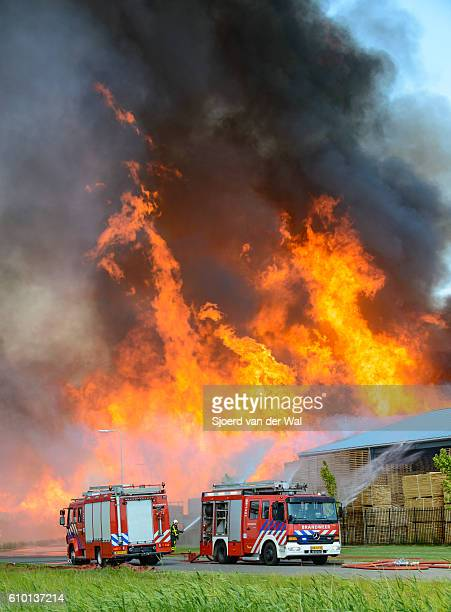 "fire engines at a fire in an industrial area - ""sjoerd van der wal"" stock pictures, royalty-free photos & images"