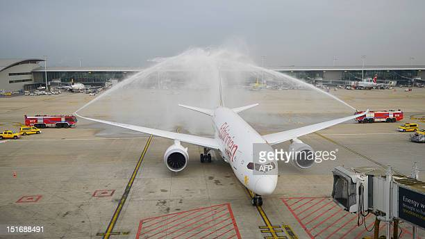 Fire engines spray water over an Ethiopian Airlines' Boeing 787 Dreamliner aircraft parked at Brussels airport for the first time on September 10 in...