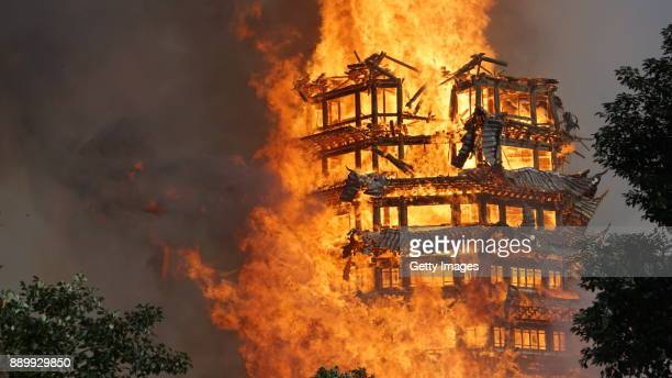Fire engulfs a 16story wooden tower at Jiulong Town on December 10 2017 in Deyang Sichuan Province of China A huge blaze has engulfed and destroyed a...