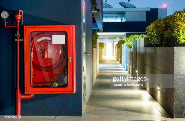 fire equipment in box, walkway area - fire stock pictures, royalty-free photos & images