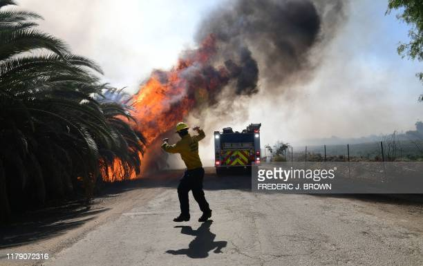 Fire erupts close to one of many ranches near the Ronald Reagan Presidential Library in Simi Valley California during the Easy Fire on October 30...