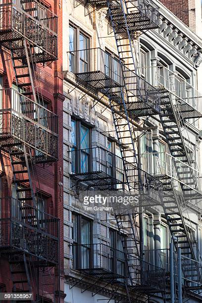 Fire Escape ladders as escape route of tenement blocks of city apartments in Soho in New York USA
