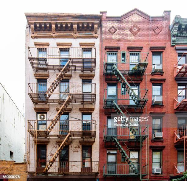 Fire escape ladders on buildings in Soho neighborhood, New York City, USA