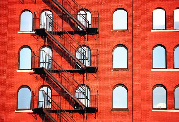 Fire Escape Of Red Building Wall Art