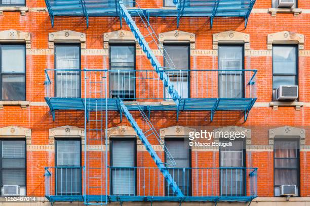 fire escape stairs on typical buildings, new york city - east village stock pictures, royalty-free photos & images