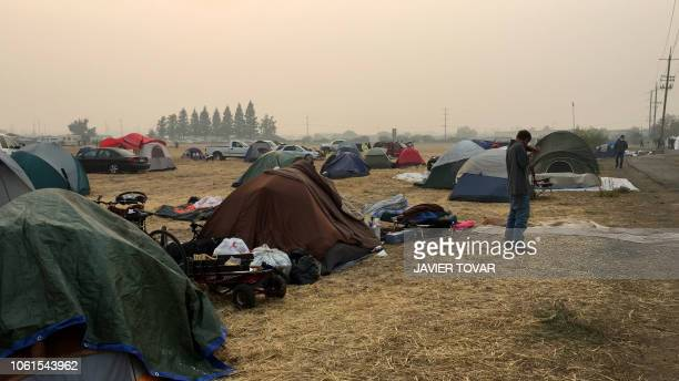 Fire evacuees camp at a parking lot in Chico California on November 14 2018 Firefighters backed by air tankers and helicopters battled California's...