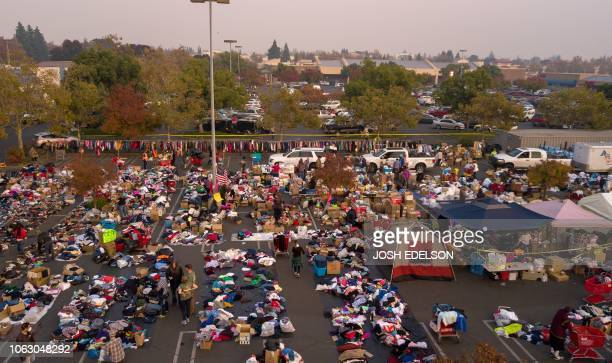 Fire evacuees sift through a surplus of donated items in a parking lot in Chico California on November 17 2018 More than 1000 people remain listed as...