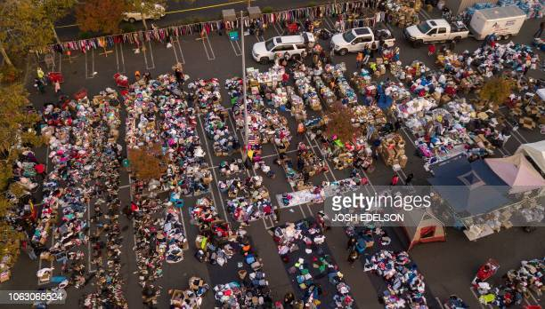 TOPSHOT Fire evacuees sift through a surplus of donated items in a parking lot in Chico California on November 17 2018 More than 1000 people remain...