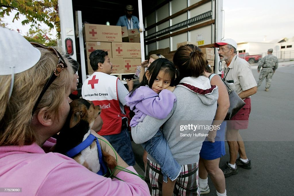 Fire evacuees who lost their homes wait in a Red Cross line for supplies at a disaster relief center at the Fallbrook Community Center October 26, 2007 in Fallbrook, California. The Witch Fire, which started outside of Ramona, CA, has burned hundreds of structures and forced thousands of evacuations as fires rage across Southern California. With improving weather conditions firefighters continued to make progress against the wildfires in California. The fires caused the largest mass evacuation in California's history, burning nearly 500,000 acres, leaving a heavy toll on the county's agricultural industry and impacting an estimated cost to the state of one billion dollars.