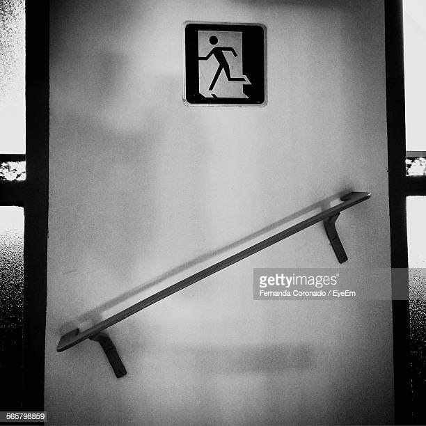 Fire Exit Sign Above Railing