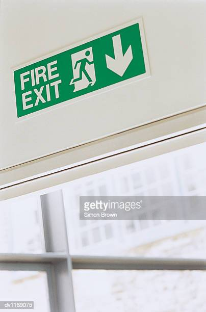 Fire Exit Sign on Top of a Door in an Office