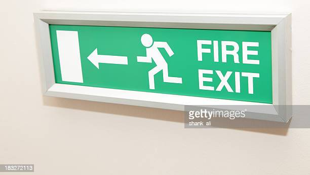 fire exit sign - evacuation stock pictures, royalty-free photos & images
