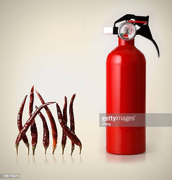 Fire Extinguisher Beside Red Chili Peppers