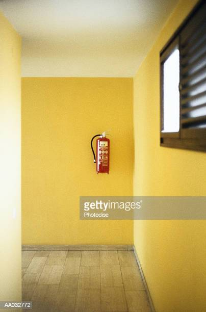 Fire Extinguisher Hanging on a Wall