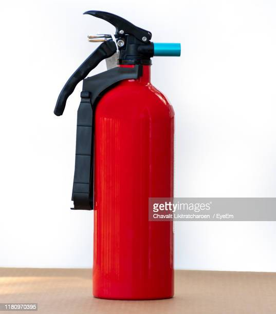 fire extinguisher of table against white background - 消火器 ストックフォトと画像